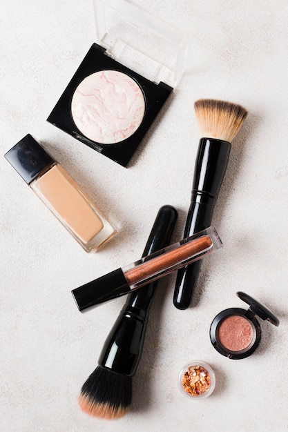 Lay out of basic tools for putting make up Free Photo