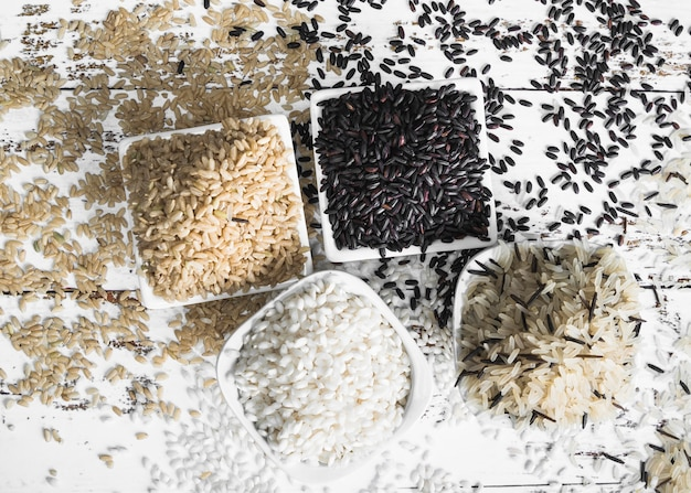 Lay out of brown black white and wild rice Free Photo