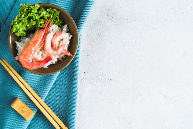Lay out of rice bowl with seafood Free Photo