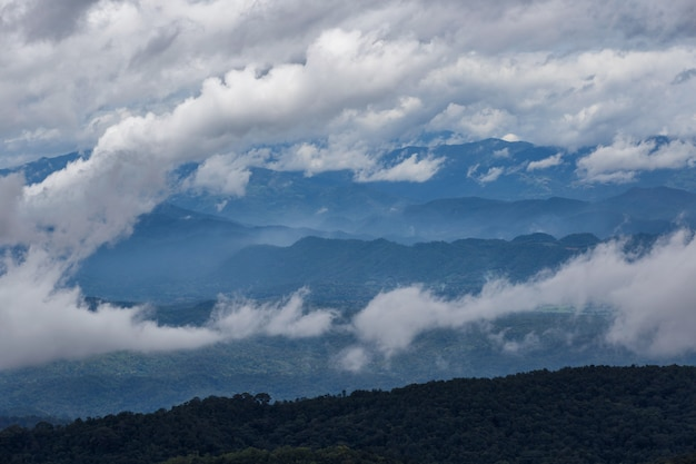 Layer of mountains and mist at sunrise time, landscape at monjam hill, high mountain in chiang mai province, thailand Premium Photo