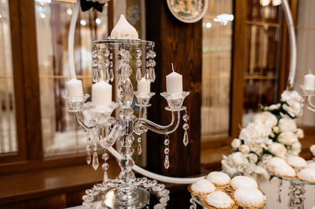 Layered candlestick stand on a holiday table Free Photo