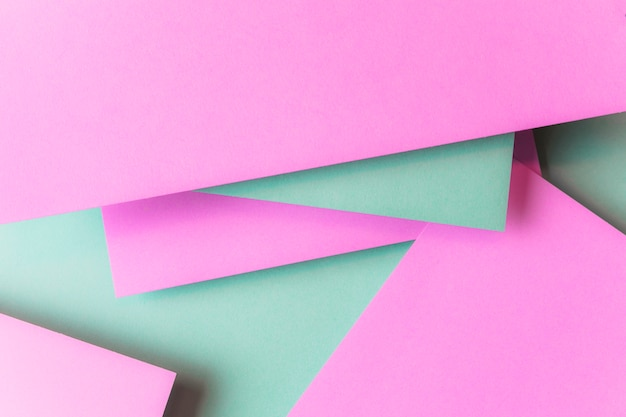 Layered of pink and green paper textured backdrop Free Photo