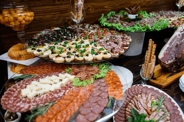Layered stands with variety of sliced meat Free Photo