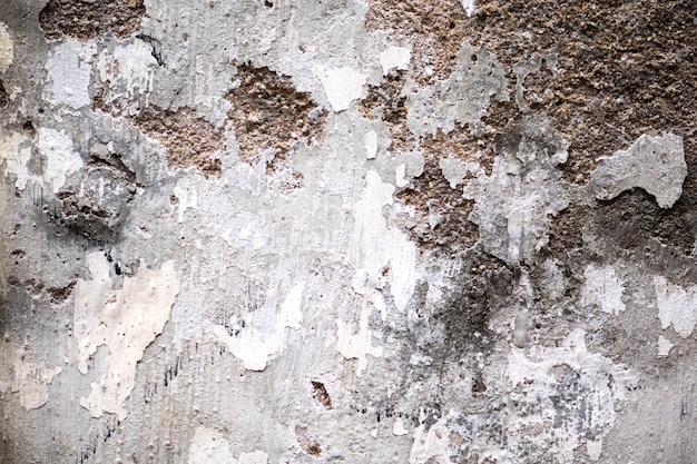 Layered wall erosion with bricks. texture of an old brick wall. Premium Photo