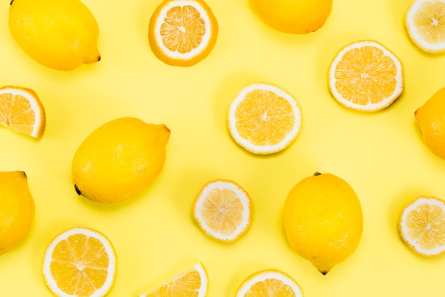 Layout of citrus fruits on yellow background Free Photo
