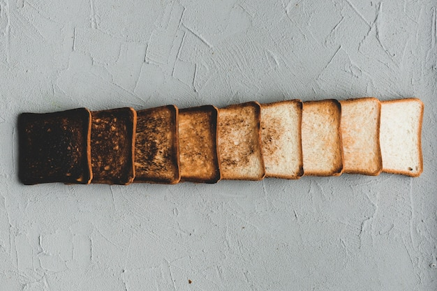 Layout of gradually burnt bread slices Free Photo