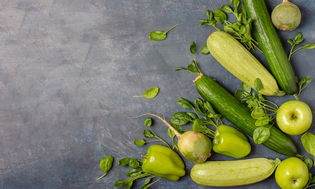 The layout of green vegetables on a dark background. Premium Photo