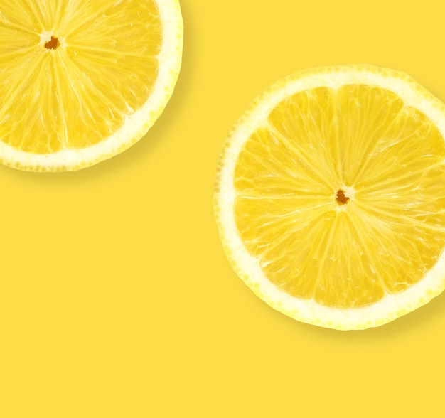 Layout the lemon on a yellow background Premium Photo