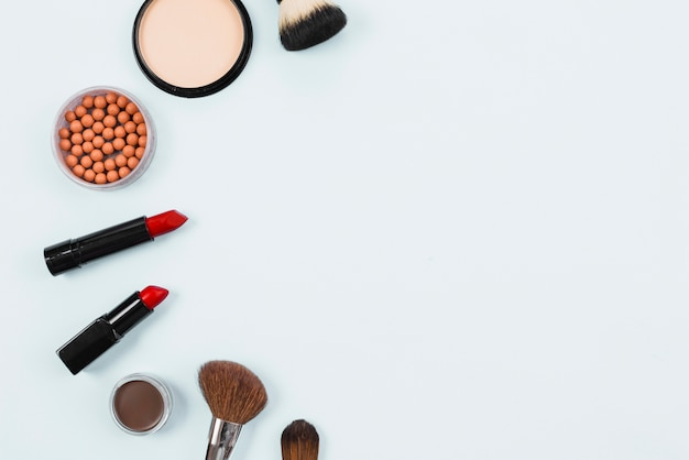 Layout of makeup beauty accessories on light background Free Photo