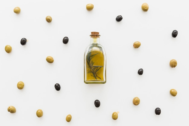 Layout of oil bottle with olives Free Photo