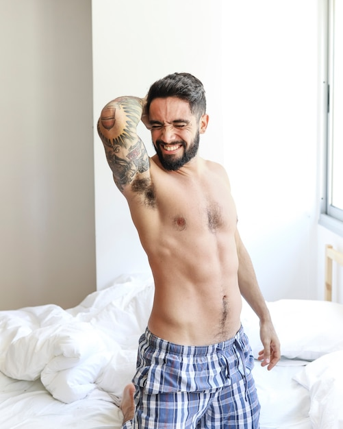 Lazy young man on bed at morning Free Photo