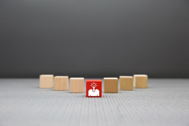 Leader  businessman graphic on wooden block. Premium Photo