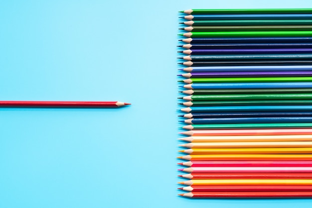 Leadership business concept. red color pencil lead presentation to other color Premium Photo