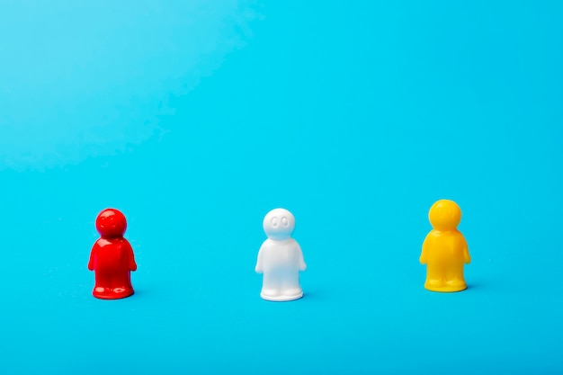 Leadership concept. on a blue background, figures of men, a red figure serves as a leader. business and work in a social team, achieving success, self-realization. establish yourself industry leader Premium Photo