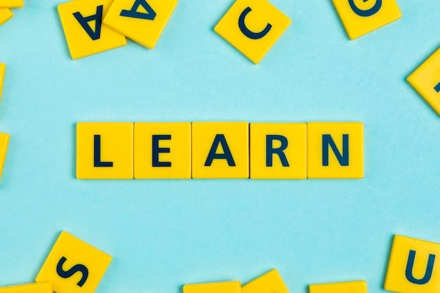 Learn word on scrabble tiles Premium Photo