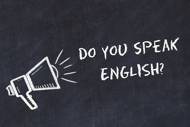 Learning foreign languages concept. chalk symbol of loudspeaker with phrase do you speak english Premium Photo