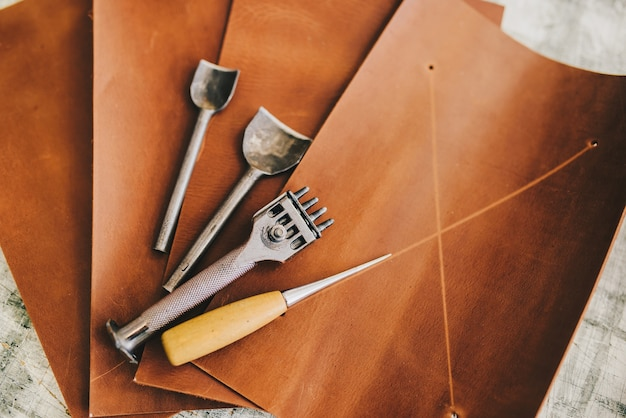 Leather crafting diy tools flat lay still life Free Photo