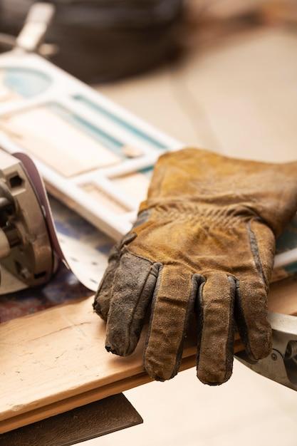 Leather gloves on artisan job table Free Photo
