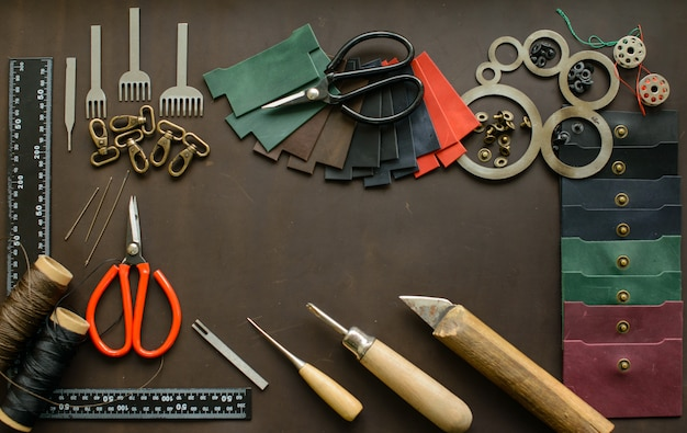 Leathersmith's work desk . leather working tools on a work table Premium Photo