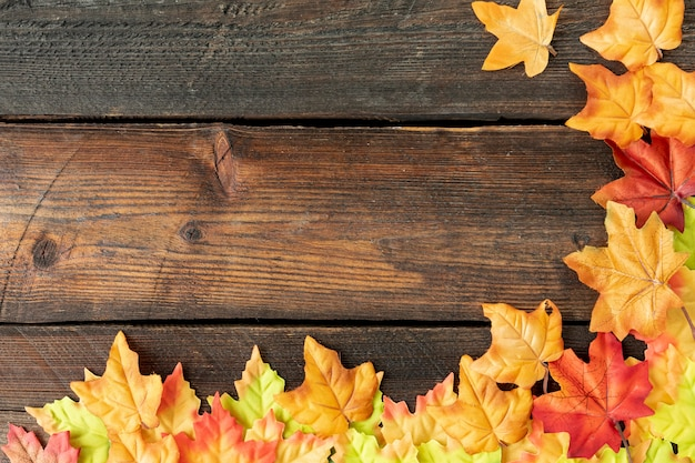 Leaves frame on wooden background Free Photo