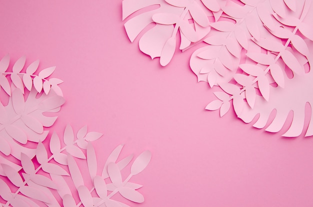 Leaves made out of paper in pink shades Free Photo