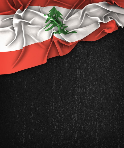 Lebanon flag vintage on a grunge black chalkboard with space for text Premium Photo