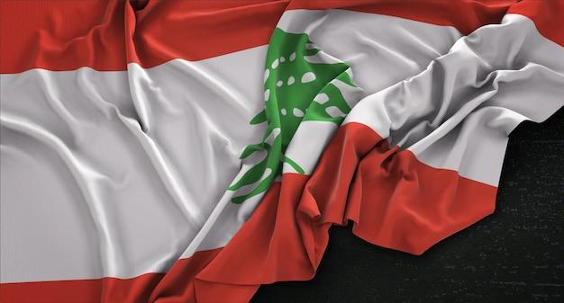Lebanon flag wrinkled on dark background 3d render Free Photo