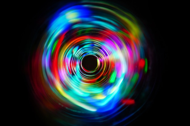 Led color rainbow light moving on long exposure shot in the dark. Premium Photo