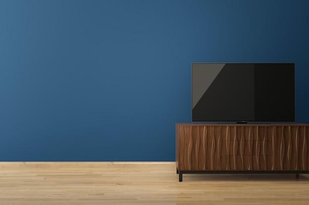 Led tv on blue wall wood floor Premium Photo