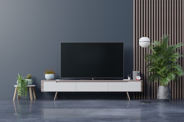 リビングルームの暗い壁にledテレビ、最小限のデザイン。 Premium写真