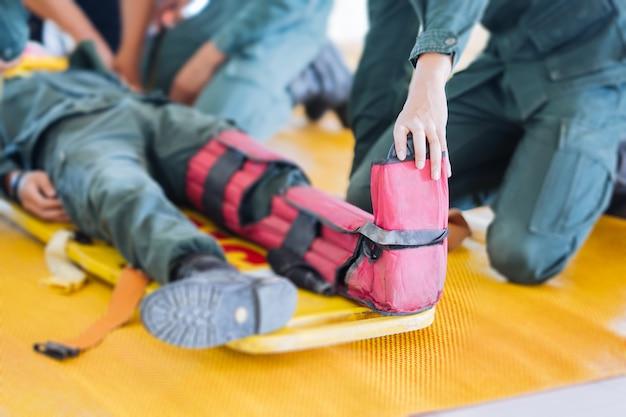 Leg patient fracture to splinters on portable stretcher Premium Photo