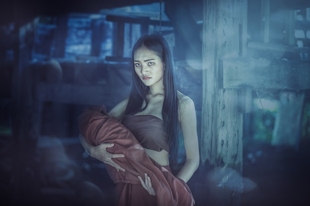 Legend of mae nak phra khanong. thai ghost concept, horror scene of scary woman with her baby ghost Premium Photo