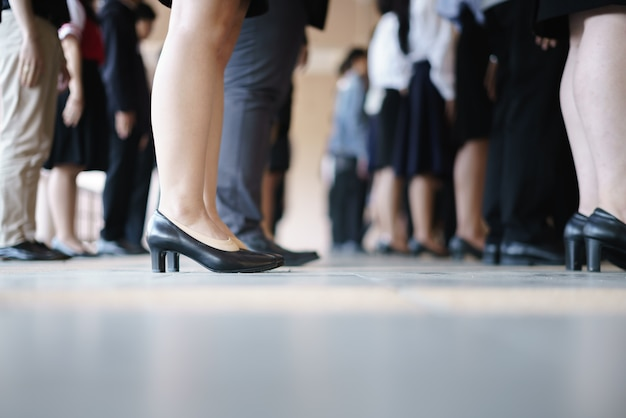 Legs of business and woman waiting in a row Premium Photo