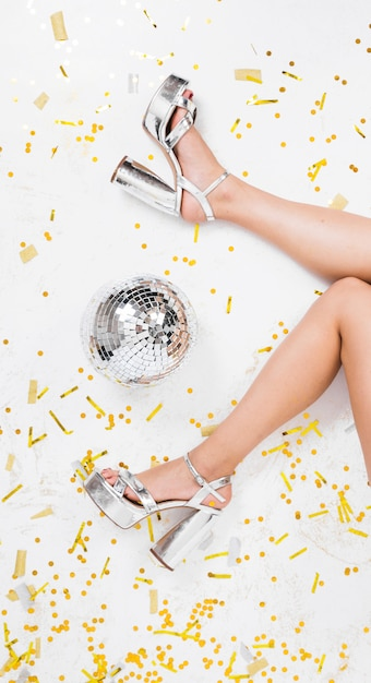 Legs in high heels on disco floor Free Photo