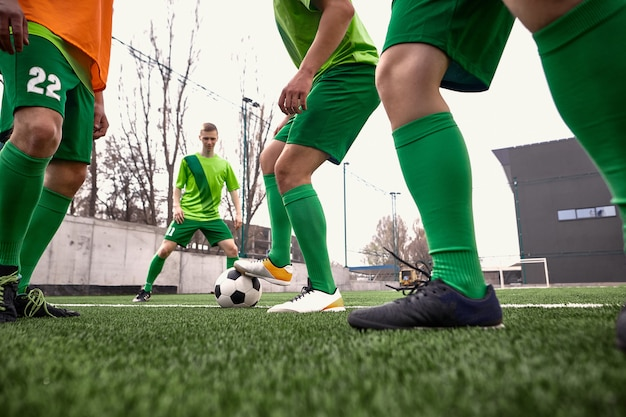 Legs of soccer football player Free Photo
