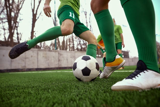 The legs of soccer football player Free Photo