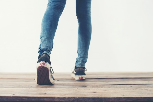 Legs walking backward and blue shoes Free Photo