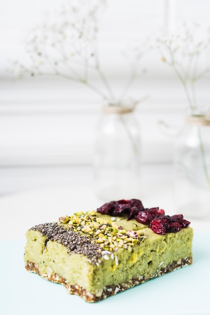 Lemon cake slices with chia seeds; pistachios and dried cranberries toppings Free Photo