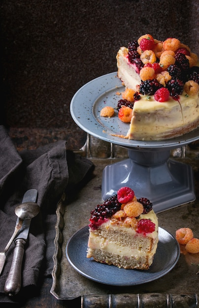 Lemon cake with colorful raspberries Premium Photo
