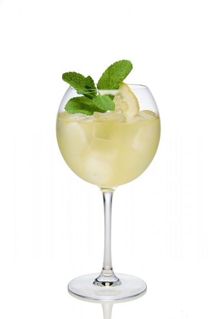 Lemon cocktail with a sparkling wine with ice cubes in wine glass isolated on white Premium Photo