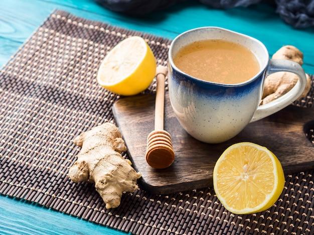 Lemon ginger hot tea drink with honey Premium Photo