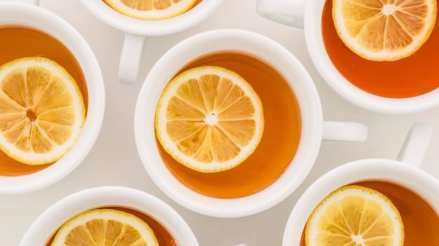 Lemon and ginger lemon tea cup on white backdrop Free Photo