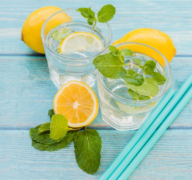 Lemon mint beverage and straws Free Photo
