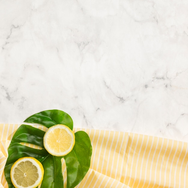 Lemon on monstera leaf with copy space Free Photo