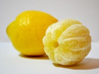 Lemon and peeled Free Photo