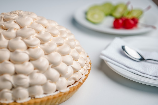 Lemon pie with fruits and a spoon Premium Photo