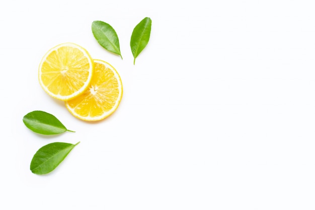 Lemon slices with leaves isolated on white. copy space Premium Photo