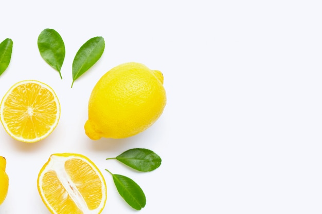 Lemon and slices with leaves isolated on white. Premium Photo