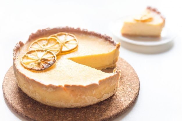 Lemon Tart With Dried Lemons As A Decoration From Above On A White