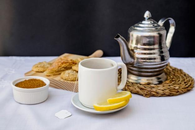 Lemon tea with brown sugar on table Free Photo
